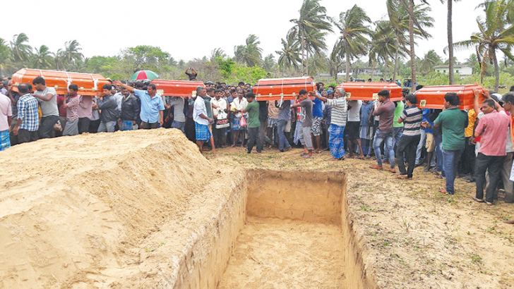 The bodies of the victims are brought to the grave site. Picture by Trincomalee Special Corr.