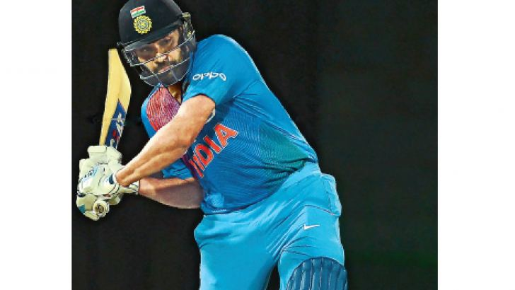 Indian captain Rohit Sharma drives off the back foot for runs against Bangladesh in the Hero Nidahas tri-series T20I match played at R Premadasa Stadium  yesterday. AFP