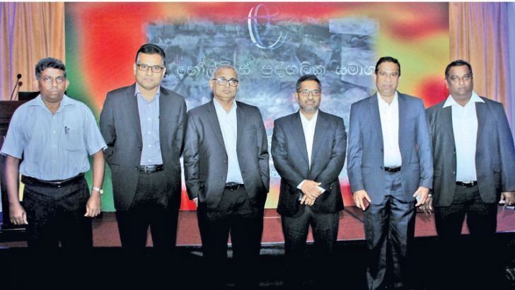 Ravindra Pitagalage, CFO with senior management of LTL. Picture by Saliya Rupasinghe