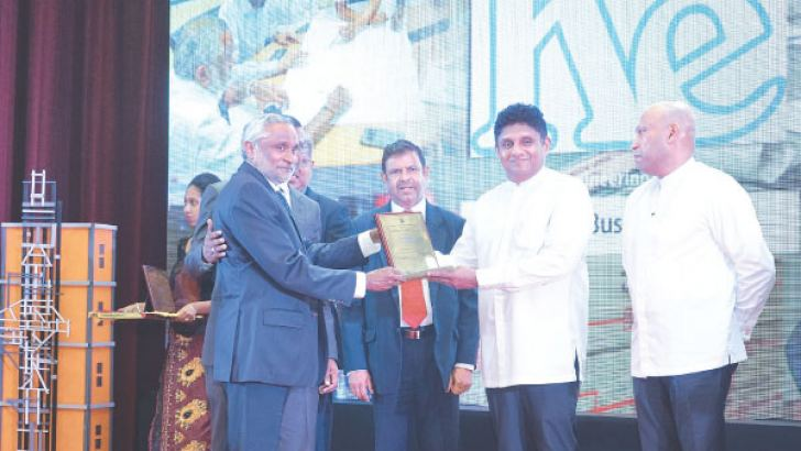 Managing Director Prasanna De Silva of Kent Engineers (Pvt) Ltd receiving the award from Hon. Minister of Housing and Construction Sajith Premadasa along with Project Manager of Kent Engineers (Pvt) Ltd Shantha Amaranathicture 2 - Director Operations Nimal Thilakasiri of Kent Engineers (Pvt) Ltd receiving the award from Hon. Deputy Minister of Housing and Construction Indika Bandaranayaka along with DGM (AC Division) Kasun Jayaweera (Far Left)