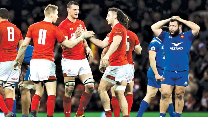 Wales' Josh Navidi and Liam Williams celebrate after the match.