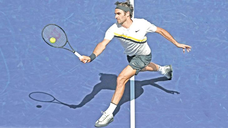 Roger Federer of Switzerland returns the ball to Borna Coric of Croatia during the semifinal match at BNP Paribas Open - Day 13 on March 17, 2018 in Indian Wells, California. AFP