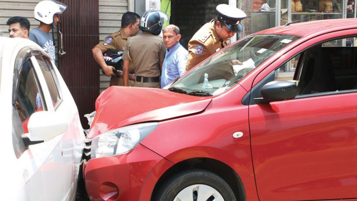 Police inspect the vehicle after the shooting  in the Armour Street Police area yesterday.