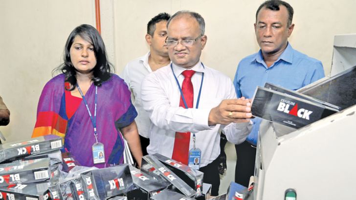 Customs officials with the seized contraband. Pictures by Rukmal Gamage