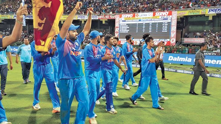 The Indian cricket team led by Rohit Sharma performing the victory lap with the Sri Lankan flag.
