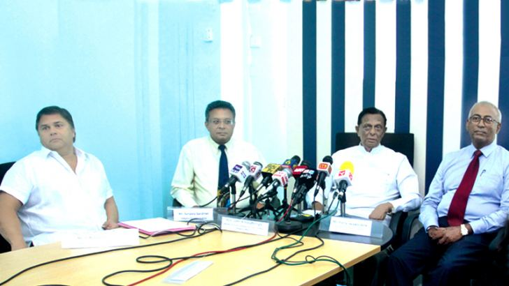 Minister John Amaratunge flanked by other officials at the event. Picture by Chaminda Niroshan