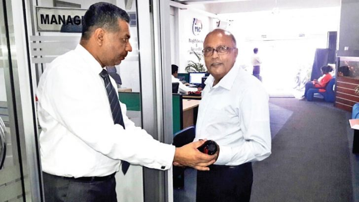 Asela Bandara, The Manager, Kandy PLC branch, presented a gift to a leading customer