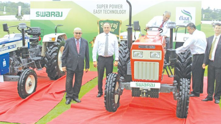 The two new Swaraj tractors being unveiled. Pictures by Saliya Rupasinghe