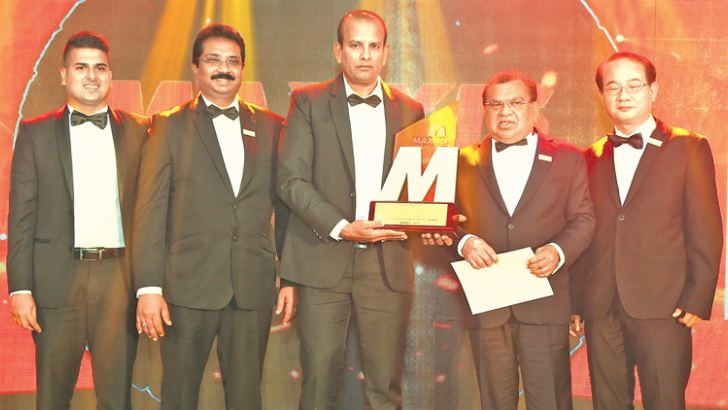 Gayan Fonseka, Director Tyre House Group, Rohan Peiris, Working Director Tyre House Group, Ravindra Premathilaka, Managing Director of Ravindra Lanka Auto Services (Pvt) Ltd,  winner of Maxxis Awrads Night 2017,  Sunil  Fonseka, Managing Director Tyre House Group and Chief  Guest Lenny Lee – Vice President, Maxxis International Taiwan
