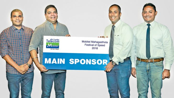 Mobitel Chief Executive Officer Nalin Perera (2nd from left) handing over the official sponsorship to Ceylon Motor Sports Club Vice President Shafraz Junaid. Also present are (from left) Mobitel Senior Manager Marketing Indika Amarasuriya and Ceylon Motor Sports Club Head of Training and Marketing, Vijitha Wijemanne.