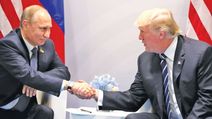 Russia's President Vladimir Putin and US President Donald Trump (R) shake hands during a bilateral meeting on the sidelines of the G20 summit in Hamburg, Germany in this July 7, 2017 File Photo. - AFP