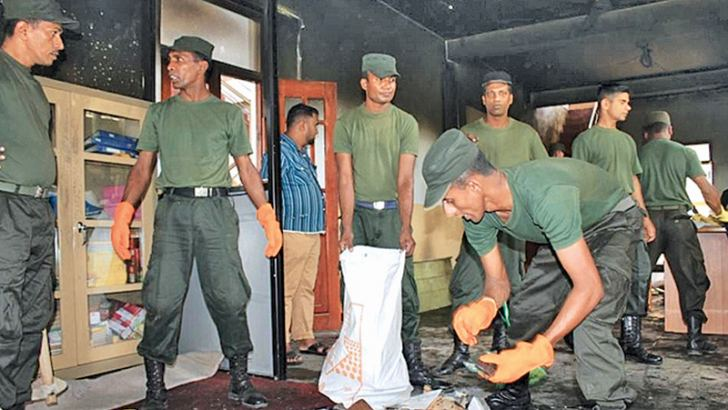 Army personnel engaged in cleaning operations