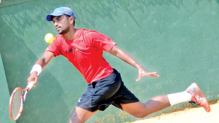 Open men's singles champion Dineshkanthan Thangaraja plays a forehand during the final against Sanka Athukorala.