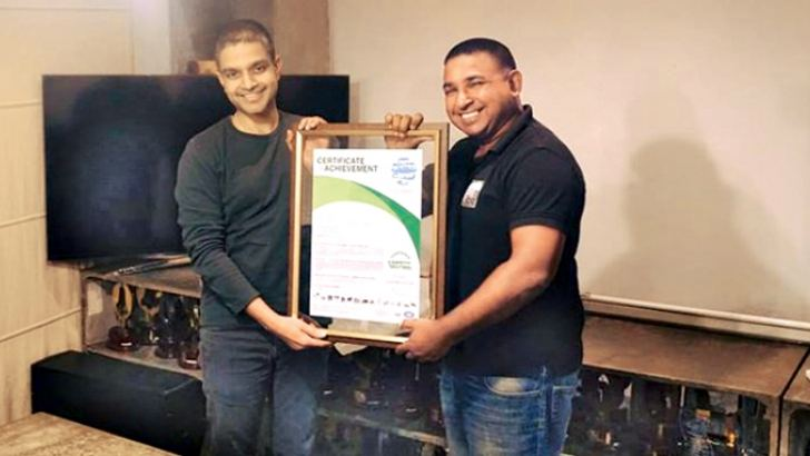 Awarding of Carbon Neutral Certification to Leo Burnett Sri Lanka CEO, Arosha Perera by The Carbon Consulting Company CEO, Sanith de S. Wijeyeratne