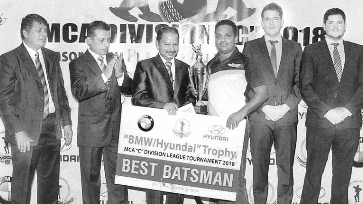 Lasith Fernando of Pyramid Wilmar Company Limited was  adjudged as the Best Batsman of the Mercantile Cricket Association 'C'  Division League Tournament 2018 played for the BMW/Hyundai Trophy. Here  Lasith Fernando is receiving his award from the chief guest at the prize  distribution ceremony. (Picture by Dilwin Mendis Moratuwa Sports  Special Correspondent)