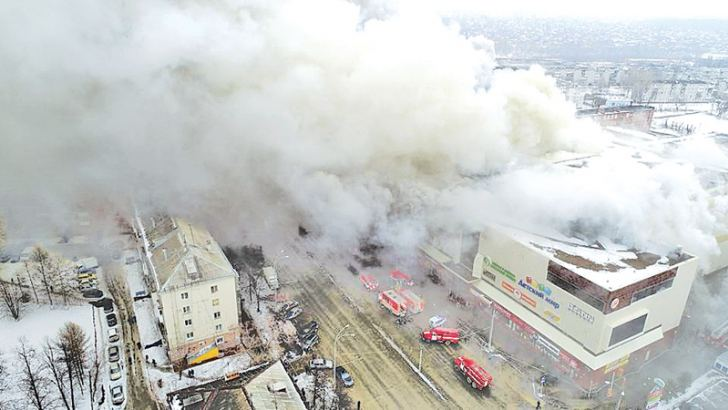 Smoke rises above a multi-story shopping centre in the Siberian city of Kemerovo, Russia on Saturday.