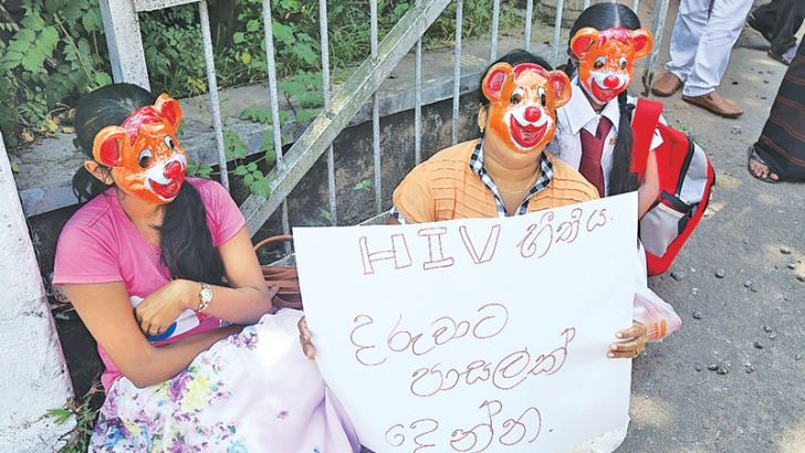 The girl and her guardians protesting.  Picture by Puttalam District Group Corr.