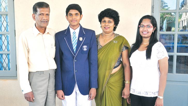 Kavin with his parents and sister.  Picture by Joseph Pius