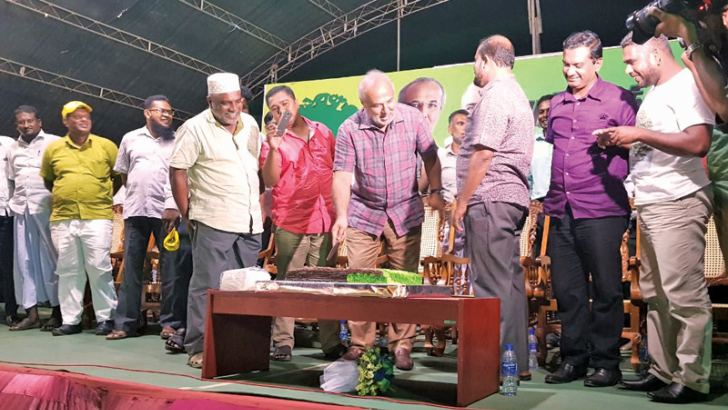 A ceremony was organised to welcome newly elected Puttalam Urban Council Chairman K..A..Baiz, on Friday (30) evening at Puttalam Colombo Face. Here SLMC Leader and Minister Rauf Hakeem cutting a cake at the event.  Picture by M.U.M. Sanoon Puttalam TKN Corr.