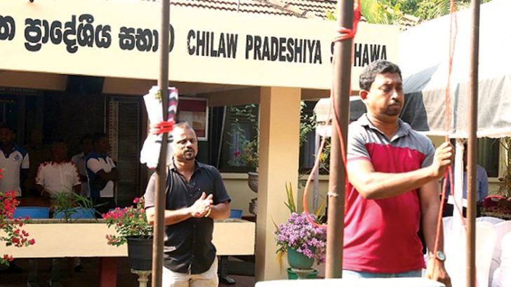 The two councillors who forcibly hoisted the national flag. Picture by Prasad Purnamal