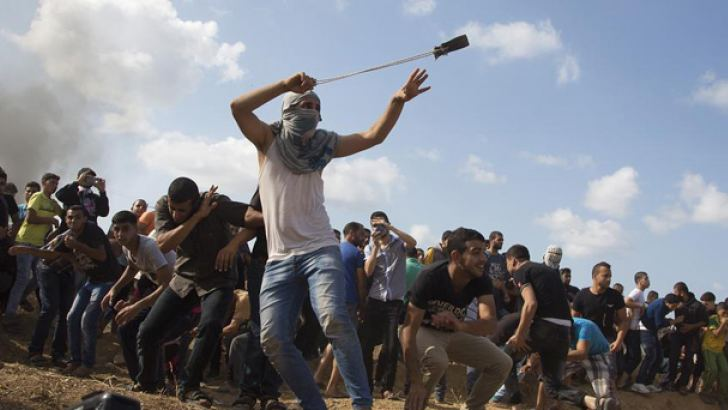 Palestinian youth in Gaza showing defiance.