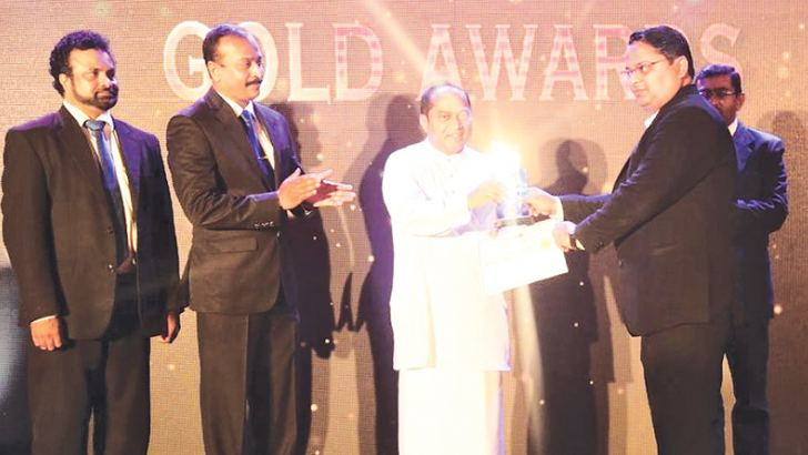 Indian Summer Restaurant, General Manager, Sharad Bajpal receiving the Gold Award from the Western Provincial Chief Minister Isura Dewapriya