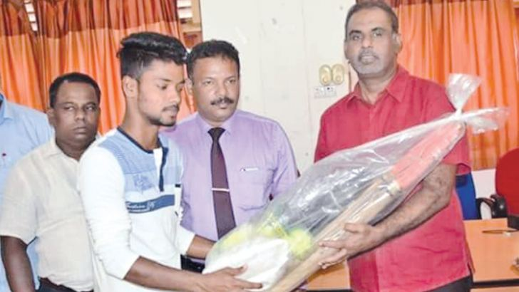 Sports gear being distributed by Sports Deputy Minister H.M.M. Harees.