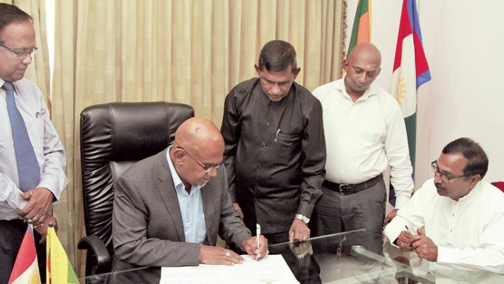 New Northern Province Acting Chief Minister Dr. K. Sarveswaran signing the official documents. Picture by Dushmantha Mayadunne.