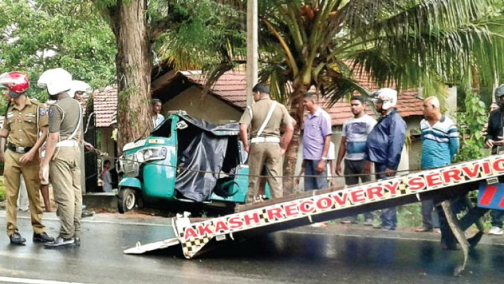 Police and residents at the scene of the accident. Picture by M. S. MUZAFFIR, Puttalam Special Corr.