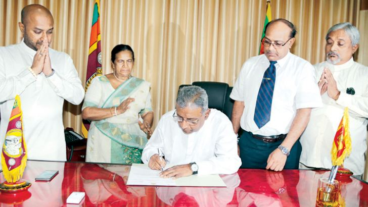 NCP Governor M. P. Jayasinghe assumes duties. Agriculture Minister Duminda Dissanayake is among those present.