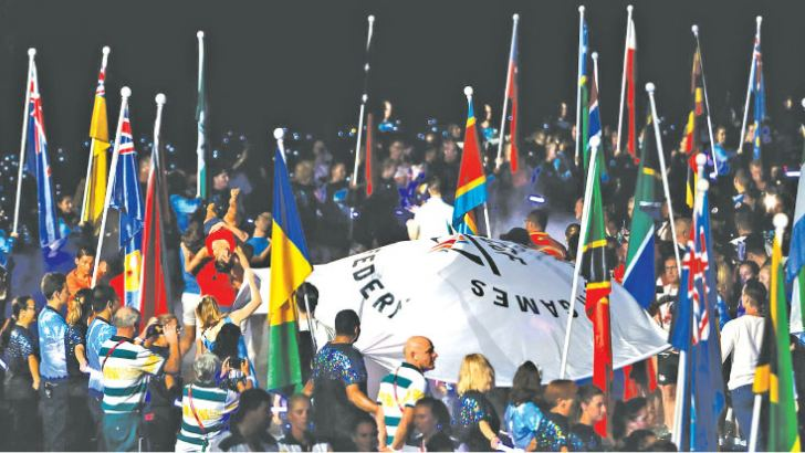 Athletes arrive into the Carrara Stadium for the closing ceremony of the 2018 Gold Coast Commonwealth Games on April 15