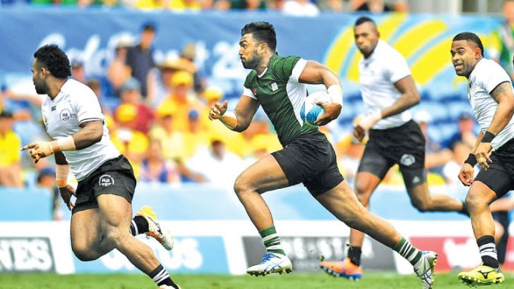 Sri Lanka centre Danushka Ranjan on his way to scoring a first minute try against world rugby giants Fiji in their opening match of the Commonwealth Games rugby sevens competition at Gold Coast.