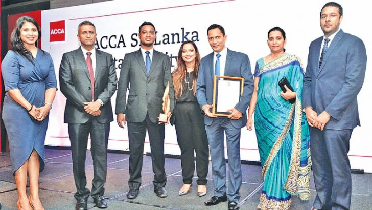 Team from Aitken Spence Hotel Holdings with Jt. Managing Director Ranil De Silva (Second L), Aitken Spence PLC Director and Aitken Spence Hotel Management Chairperson Stasshani Jayawardena after receiving the award and AVP Finance Dhammika Ekanayake