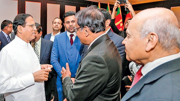 President Maithripala Sirisena who is on an official visit to Britain for the Commonwealth Heads of Government Meeting (CHOGM) met Sri Lankans living in London yesterday. Picture by Sudath Silva.