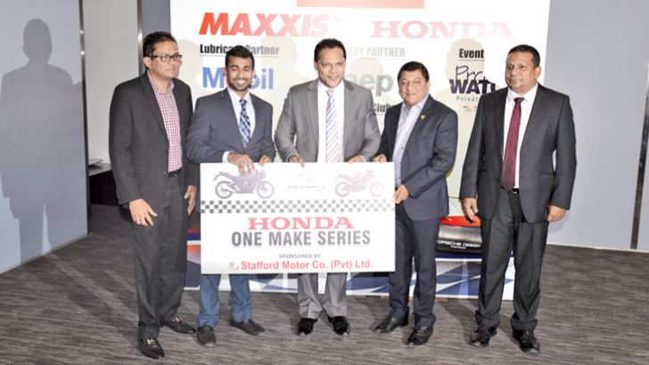 Tarindra Kaluperuma, Executive Director- Stafford Motors (02 nd from Left) handing over the sponsorship cheque of Honda One Make Series to Sports Minister Dayasiri Jayasekara