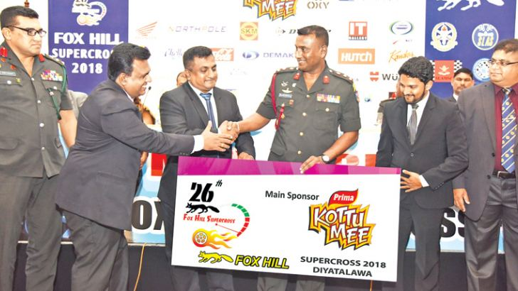 Team KottuMee handing over the sponsor cheque to the Chairman of the Organization Committee Brigadier H H A S P K Senaratne RSP psc