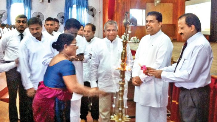 Land and Parliamentary Reforms Minister Gayantha Karunatileka and others lighting the oil lamp. Picture by THENNAKOON BANDARA, Moneragala Daily News Corr.