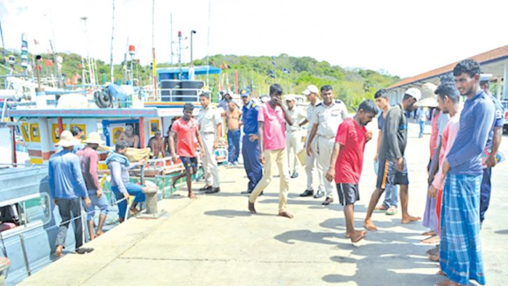 The Navy with the apprehended fishermen.