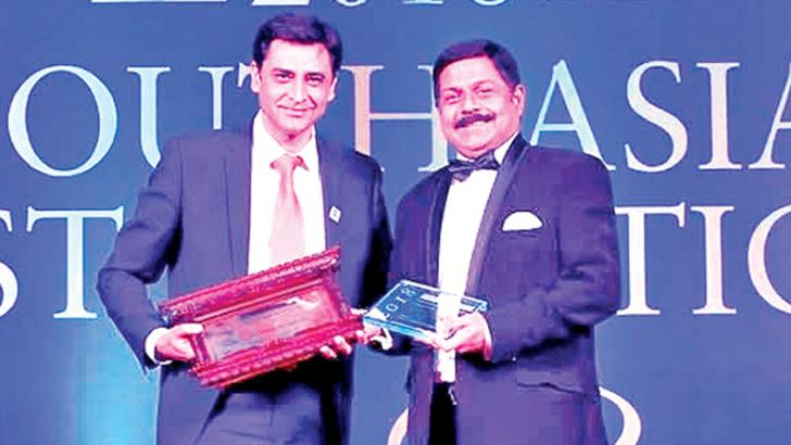 Commercial Bank Chief Operating Officer S. Renganathan  receives the award.