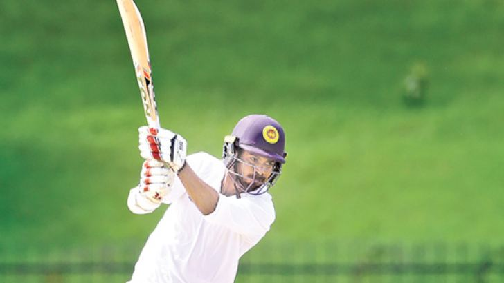Upul Tharanga of Galle hits on the off side during his knock of 103 against Kandy at Hambantota yesterday.