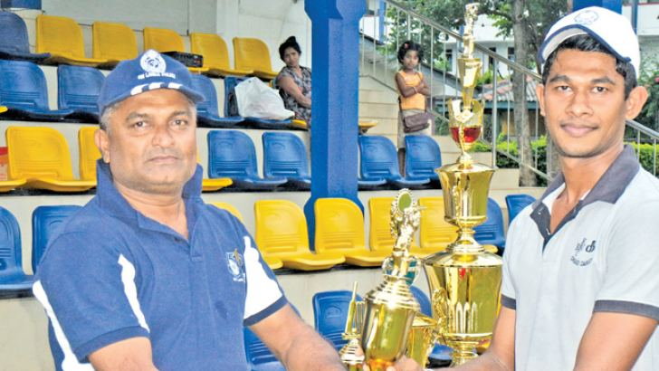 Arunraj of Kandy Police, Best player of the tournament receiving award From Chief Inspector of Peradeniya Police H.S.M.Caldera.  Picture by Upananda Jayasundera,  Kandy Sports Special Correspondent