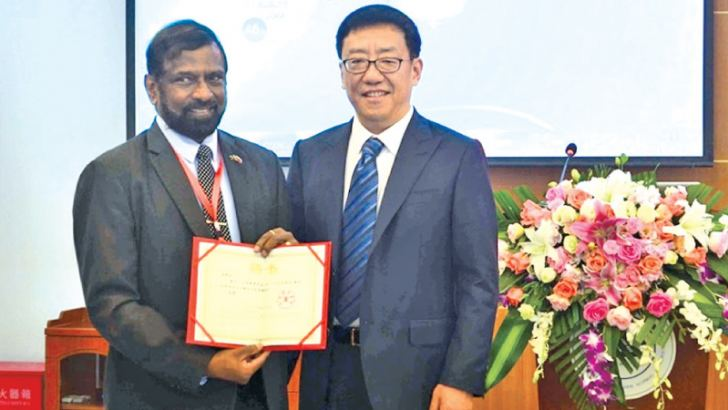 Admiral Dr. Jayanath Colombage, Director, Center for Indo-Lanka Initiatives and Centre for the Law of the SeaReceiving a Guest Professorship from  Professor Hu  Dan, the President of Leshan University