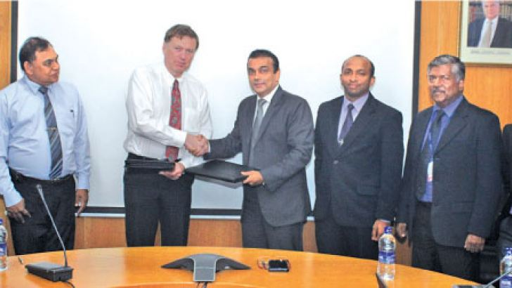 Prof. Peter Barrington, Head of the Department of Aerospace and Aircraft Engineering of Kingston University and Primal De Silva, General Manager, SriLankan Aviation College, together with Prof. H. Y. Ranjit Perera, Dean of IESL College of Engineering Sri Lanka, and Management and Engineering Instructors of SriLankan Aviation College after signing the MOU at the SriLankan Airlines' Airline Centre at Bandaranaike International Airport.