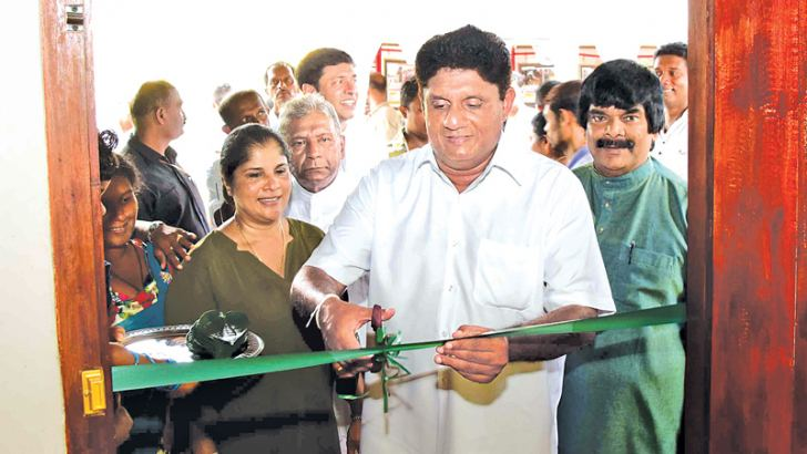 Minister Sajith Premadasa opening a new housing unit.  Picture by Nimal Wijesinghe, Anuradhapura Additional District Group Corr.