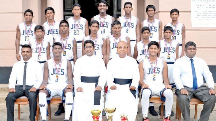 The all island U-15 Div. 'A' basketball champions, ST. Joseph's College team with Rev. Fr. Travis Gabriel (Rector), Rev. Fr. Milan Bernard (Prefect of Games), Shane Daniel (Coach) and Asiri Caldera (Master in charge).