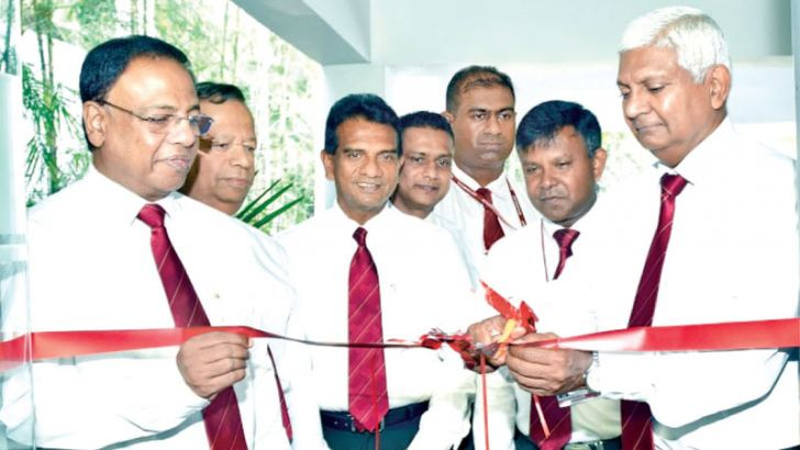 Ceylinco Life Managing Director R. Renganathan and Directors Devaan Cooray and Palitha Jayawardene at the opening.