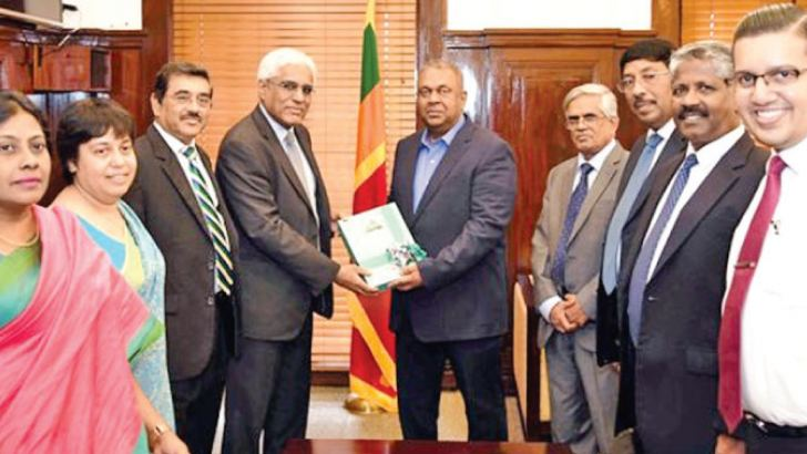 Governor Central Bank Dr. Indrajit Coomaraswamy hands over the First copy of Annual Report - 2017 of the CBSL to Minister of Finance and Mass Media  Mangala Samaraweera yesterday at the Treasury. Secretary to the Treasury Dr. R.H.S. Samaratunga, Senior Deputy Governor Dr. P. Nandalal Weerasinghe were present at the occasion along with CBSL officials,  K.D. Ranasinghe, Deputy Governor,  C.J.P. Siriwardena, Deputy Governor, Dr. Yuthika Indraratne, Director Economic  Research, Dr. C. Amarasekara, Add. Director