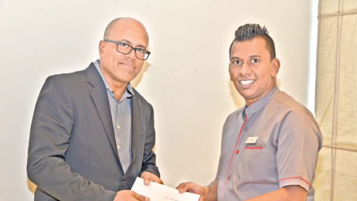 General Manager Terrence Fernando with Saliya Silva from Food and Beverage, who received the Associate of the Quarter, Front of House award