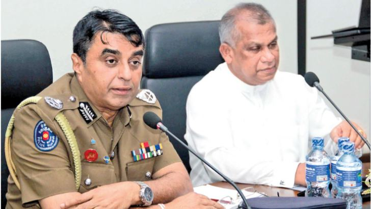 Law and Order Minister Ranjith Madduma Bandara and IGP Pujith Jayasundara  at the media briefing on Tuesday.