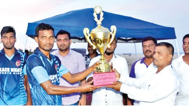 Addalaichenai Black Night Sports Club skipper receiving the trophy.